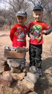 Oliver and Nathan with the rock tower they built